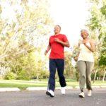 Older couple jogging outside