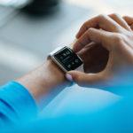 Hand touching smart watch